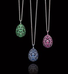 Classic Fabergé: emerald and pink and blue sapphire Egg Pendants.