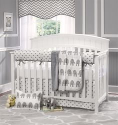 Gray Elephant Baby 4-pc. Bedding Set from Liz and Roo. This beautiful white and gray crib bedding set includes polka dots rail cover and dust ruffle, a white and gray elephants minky blanket and a white crib sheet. You'll love this baby bedding set, and will sleep easy knowing it is 100% made in America. Shop Liz and Roo Fine Baby Bedding now at www.LizandRoo.com