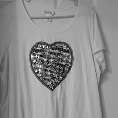 White heart tee White tee with silver heart. I've never worn this shirt. It is fitted so it wears like a 1X. Really cute! Dress Barn Tops Tees - Short Sleeve
