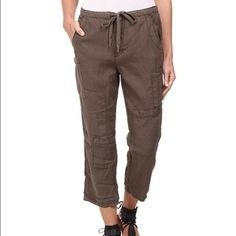Free people linen cropped utility pants Slouchy linen utility pants. Elastic-back drawstring waist. Zip fly and snap closure. Two front pockets. Allover pocket detailing. 100% linen. Hand wash cold, hang to dry. Imported. Product measurements were taken using size XS (Women's 0-2).  Measurements Waist Measurement: 30 in Outseam: 33 in Inseam: 24 in Front Rise: 11 in Back Rise: 16 in Leg Opening: 16 in Free People Pants Ankle & Cropped