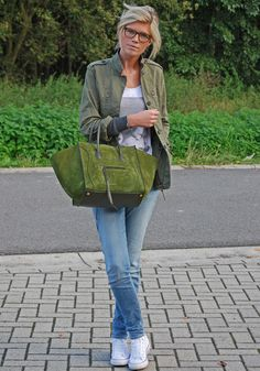 Play with tone on tone color schemes — we love the way this army jacket gets a complementary finish from her rich moss-green Celine tote. Source: Lookbook.nu