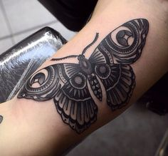 Check out the moon and star detail on this moth tattoo.