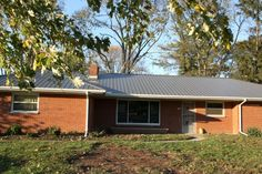 Hubby wants a metal roof... Me, not so much. But, this family really likes theirs. Worth considering?