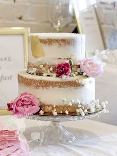 Floral and gold leaf semi-naked bridal shower cake