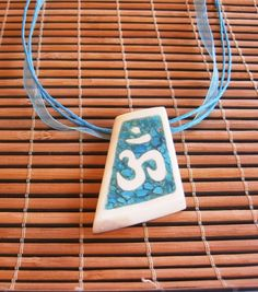Fine pendant made by bone nad natural turquoise