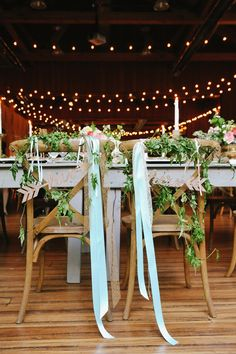Love these wood his and her arrows for the wedding party table!