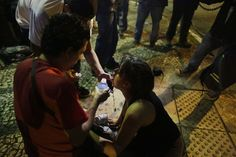 A girl suffering from the effects of tear gas used by police is helped during a protest in Sao Paulo, on June 17, 2013. (AP Photo/Nelson Antoine