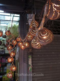 Wooden Hanging Lamp from Coconut Shell HANDMADE  This amazing hanging lamp made from coconut shell in Thailand, it emits a soft light and