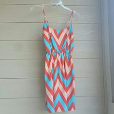Bright chevron print dress with cutout on sides Bright chevron pattern. Spaghetti straps. Elastic band around waist. Cutout sides shown in second picture. 100% polyester. tyche Dresses Mini