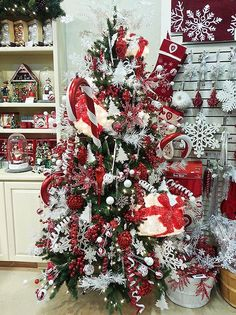 I call this the Polish-American tree at Treetime because of the rich reds and white colors throughout.  It is such a unique and beautiful way to decorate an artificial Christmas tree! One of the great features of a fake tree is its ability to flex and bend to all sorts of decorating themes.  How else could you fit a lighted gift box and a huge candy cane right in?! Decorations and the best pre-lit trees at www.treetime.com