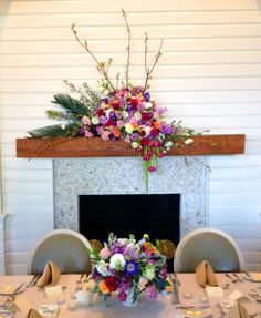 Tabby Room, special events venue in South Carolina. The fireplace mantle featured a stunning springtime floral display featuring blossoming branches, tulips, lilacs, roses, hydrangeas, and palm fronds. Flowers by Tei Tober of Artistic Endeavors - Dataw Island Club Special Events. Beaufort, SC