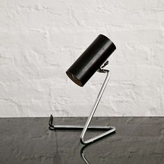 Gino Sarfatti; #551 Enameled Metal and Chromed Tubular Steel Table Lamp for Arteluce, 1951.
