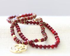 Beautiful Red OM Mala Necklace or Wrist Mala by BadDog1976 on Etsy