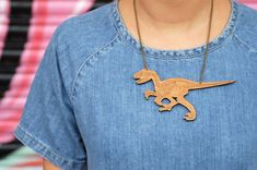 "Who wouldn't want this velociraptor running around their neck? | 19 Incredible Dinosaur Necklaces Every ""Jurassic Park"" Fan Needs"