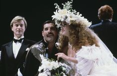 Freddie Mercury - centre, left) of Queen with actress Jane Seymour at the Fashion Aid show in aid of African famine relief, UK, November (Photo by Georges De Keerle/Getty Images) Jane Seymour, Freddie Mercury, Queen Photos, John Deacon, Most Handsome Men, Falling In Love With Him, The 5th Of November, Wedding Album, Record Producer