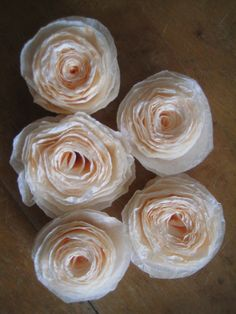 Learn how to make easy and beautiful coffee filter flowers. They can be used for home decor, gifts, even wedding or party decorations. An easy and fun craft project using supplies you already have!