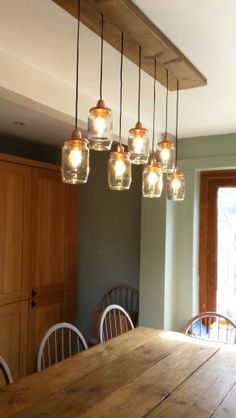 Our jar lights above our scaffold board table. Kitchen finally coming together