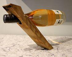 Zero gravity wine bottle holder made from wine barrel staves
