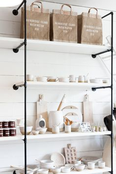 The store offers a wide array of wares from Farmhouse Pottery based in Woodstock. Retail Wall Displays, Gift Shop Displays, Visual Merchandising Displays, Store Displays, Window Displays, Shop Shelving, Retail Shelving, Storage Shelving, Shelving Ideas