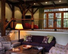 Sunken in living room... railing...exposed beams...french doors w/ windows... don't like the colors...