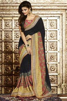 Black Georgette Saree With Art Silk Blouse Pirce:£215 Black georgette saree with pink art silk blouse.  Embellished with embroidered, resham, zari, stone and hand.  Saree comes with u neck blouse.  Product are available in 34,36,38,40 sizes. It is perfect for casual wear, festival wear, party wear and wedding wear.  http://www.andaazfashion.co.uk/womens/sarees/black-georgette-saree-with-art-silk-blouse-dmv8752.html