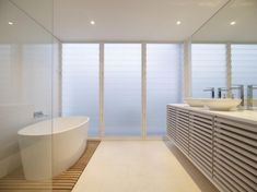 love the wood floor, louvers and white cupboards but would prefer the vanity top to be wood.