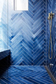 Amazing blue shower made with Made a Mano Cristalli lava stone tiles