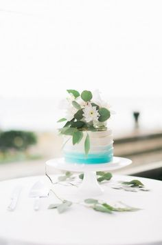 single tiered buttercream cake with light blue accent and fresh flowers by Cake by Nicole, vancouver wedding cakes, vancouver pastry chef