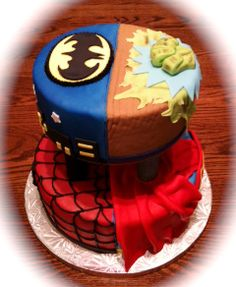 Superheroes Birthday Cake: This is a basic yellow cake filled with vanilla pudding.    The cakes are decorated in fondant and separated with white pillars that I covered in fondant