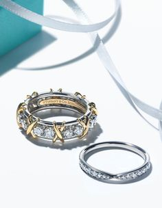 Which extraordinary Tiffany wedding band are you dreaming of? Shown: Tiffany & Co. Schlumberger® Sixteen Stone and Tiffany Harmony® rings.