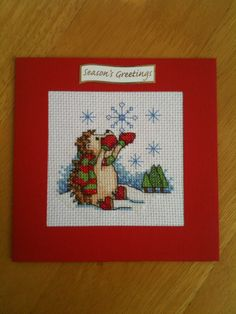 Handmade cross-stitch christmas card - hedgehog with snowflakes by ZeldaAndKath on Etsy https://www.etsy.com/listing/203446712/handmade-cross-stitch-christmas-card