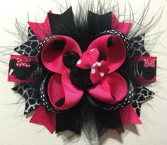 A personal favorite from my Etsy shop https://www.etsy.com/listing/265746418/pink-minnie-mouse-stacked-hair-bow