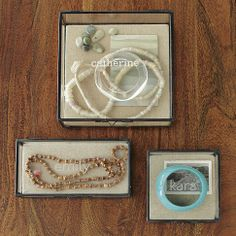 Glass Shadow Boxes. They can be wall mounted and monogrammed.