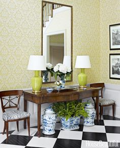 Updating the floor with a custom-painted checkerboard dramatically changed the entry of a Long Island home. Side chairs got a face-lift with fabric by Bob Collins & Sons. Ginger Jar lamps by Christopher Spitzmiller. Trim in Benjamin Moore's White Dove.