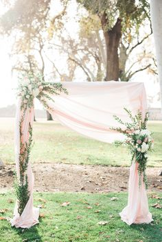 romantic wedding ceremony arch - photo by Hannah Gaul Photography http://ruffledblog.com/feminine-ethereal-wedding-inspiration/