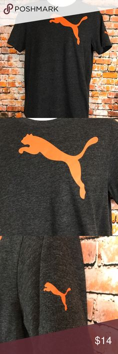 """Puma Size S Short Sleeve Men's Tee Shirt Barely Worn. Puma Men Size Small TShirt. Charcoal gray with orange puma cat. Short Sleeve.  Missing feels like Cotton and Polyester. Chest approx 41"""". Length approx 27 1/2"""". Puma Shirts Tees - Short Sleeve"""