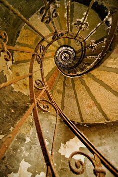 Spiral Staircase. The stairway does not change size - it is an optical illusion - the effect of your own perspective.What is fascinating is that the decrease in apparent size follows the Fibonacci formula.