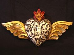 Winged heart with 'milagros'