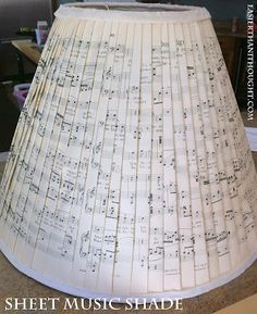 Sheet music lampshade tutorial at Easier Than I Thought.
