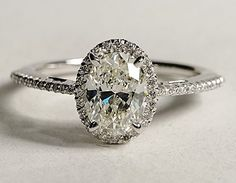 I love the simple thin band, the small accent diamonds and the timeless oval cut center. This would be classic, timeless, beautiful, simple, and not gaudy.
