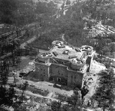 An immediate postwar aerial view of the large anti-aircraft FlaK tower in Berlin's Tiergarten, showing heavy artillery and bomb damage (1945).