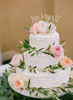 Textured pink floral topped wedding cake: http://www.stylemepretty.com/florida-weddings/fort-myers/2016/02/15/sweet-organic-florida-beach-wedding/ | Photography: Jody Savage Photography - http://jodysavagephotography.com/
