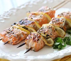 Kebabs--For Lunch, Dinner and Dessert: Grilled Salmon and Lemon. Salmon holds up surprisingly well on a skewer especially when buttressed by tart lemon wedges; they add brightness and texture to these light kebabs. #SelfMagazine