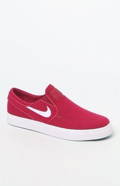 PLEASE NOTE: This shoe is offered in Men's sizes; please consult the Size Chart above - the conversion is a size and a half smaller for women. For example, a woman who is a size 7.5 should order a size 6 in Men's.  The Nike SB Zoom Stefan Janoski Slip-On Canvas Sneakers have a streamlined, low profile with a lightweight canvas construction. The perfect skateboarding shoe, these slip-on canvas sneakers are complete with Zoom Air cushioning for low-profile impact protection and a herrin...