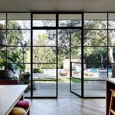 """The wall of black-steel-framed windows and doors is something Rachel was very particular about. """"The doors were custom-made in Melbourne, brought up on a truck and installed over a few days. Two things I refused to compromise on were the windows and floor House Design, House, Home, Windows, Windows And Doors, House Exterior, House Styles, New Homes, Black Window Frames"""