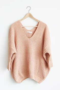 "Details Size Shipping • 60% Cotton 40% Polyester • V-neck balloon chenille yarn sweater. • Hand Wash • Line dry • Imported • Measured from small • Length 27"" •"