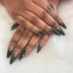 Matte khaki stiletto nails with gold leaf and freehand nail art