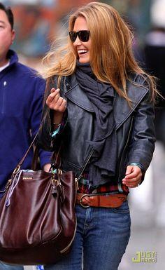 biker jacket, plaid shirt, leather belt, perfect fitting jeans, scarf, great bag, dark shades, killer smile