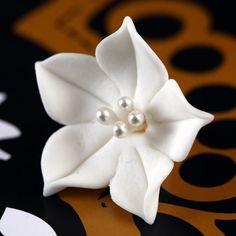 Small White Gumpaste Apapanthus SugarFlower Blossom handmade cake topper decoration.   www.CaljavaOnline.com #caljava #sugarflower