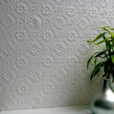 This fabulous floral design brings an intricate tiled look to walls that's fresh and sophisticated. A paintable wallcovering full of spectacular beauty that can